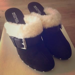 Michael Kors shearling lined clogs.